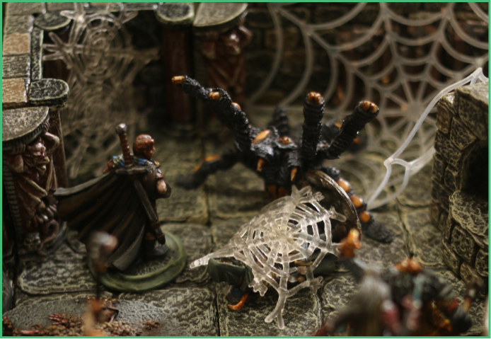 Image of D and D characters fighting giant spider